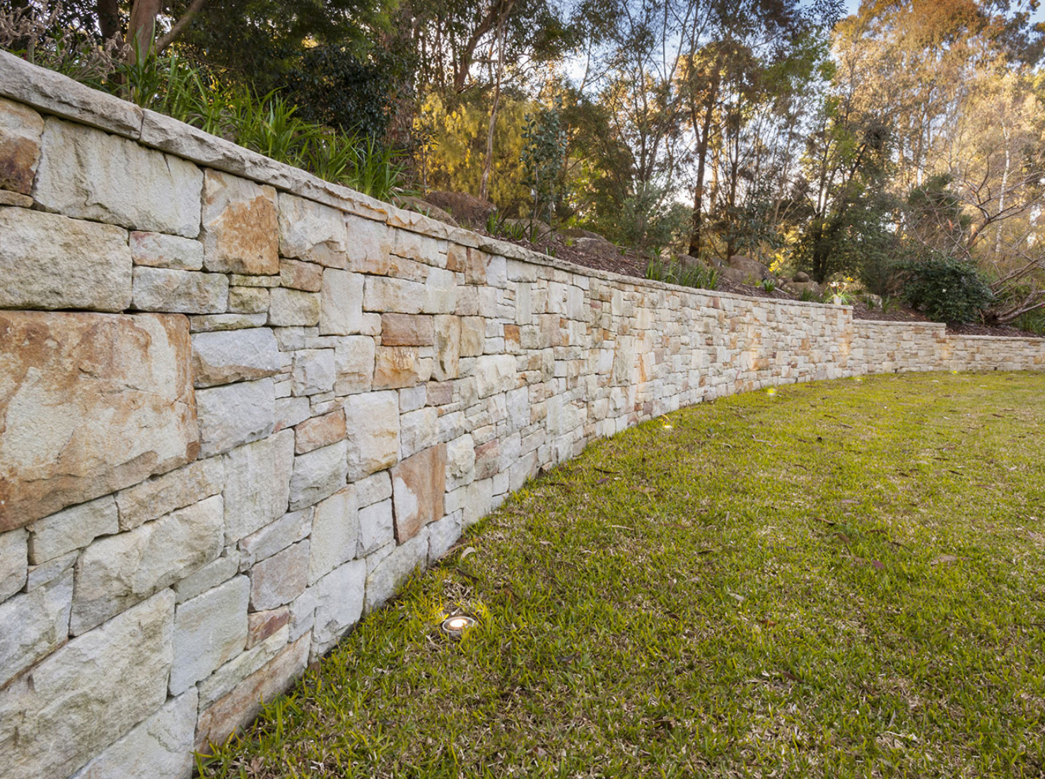 curved retaining wall in backyard
